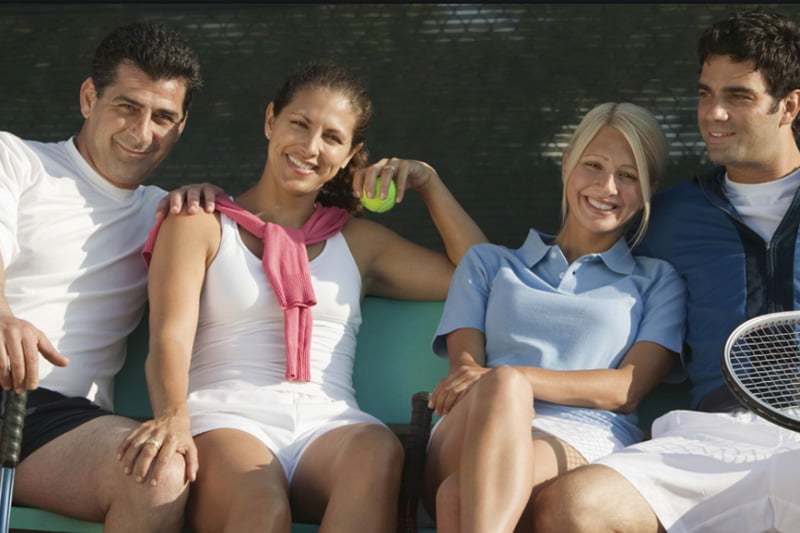 Two couples playing Social tennis