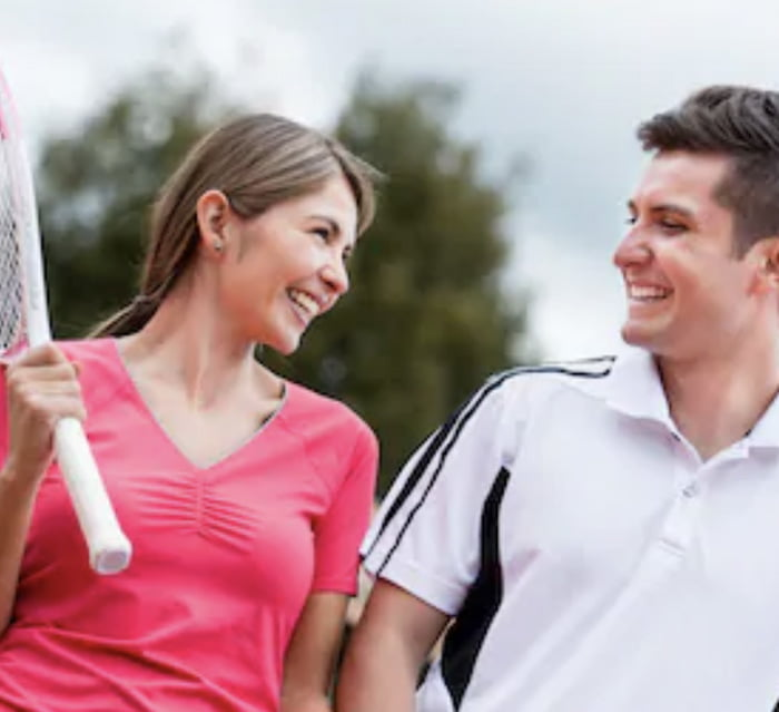 Man and Woman playing Social Tennis